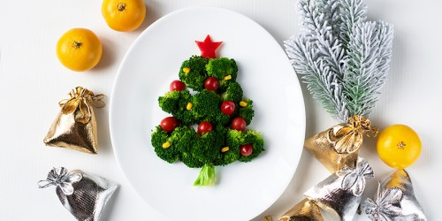 Christmas edible tree made from broccoli, tomato and corn on a w