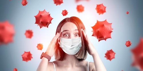 Scared young girl in medical mask, coronavirus